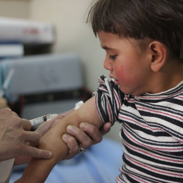 On 26 April 2016, Louai, 4, is vaccinated in Aleppo City as part of Syria's first ever nationwide routine immunization campaign since the start of the five year conflict. Until recently, the siblings lived in Al-Bab town in rural eastern Aleppo, one of the most dangerous areas to live due to the war. Their mother recently fled with her children to shelter with relatives in Aleppo city. Hearing about the campaign from neighbours, she took her four children to the nearest health centre, along with their cousin. The first full nationwide immunization campaign since the start of the five-year conflict in Syria, began on 24 April 2016, at the start of World Immunization Week. The campaign, supported by UNICEF and WHO, aims to reach all children under the age of five years old including those living under siege and in hard-to-reach areas, where routine vaccination is almost non-existent and many children have never received any vaccinations. Access to children in these areas is key to the success of the campaign. After five years of conflict, national immunization rates have dropped from 90 per cent to 57 per cent, putting the country's 2.8 million under-five-year-old at risk of life-threatening vaccine preventable diseases. In this campaign, children will be immunized against polio, measles, rubella, pertussis (whooping cough), diphtheria, tetanus, hepatitis B and haemophilus influenza type B. Access for health workers is critical to protect these children from deadly diseases. Vaccination is being provided through fixed health centres, outreach activities and mobile teams where required.