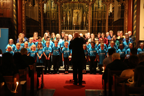Students from Allfarthing Primary School giving a rendition of Away in a Manger with the Joyful Company of Singers. Unicef UK 2014