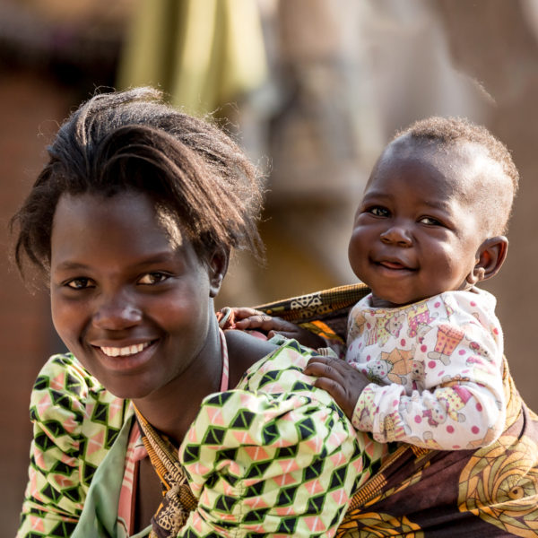 Leaving a gift in your Will can create a safer world for children. Martha, 19, carries her son Rahim, who is eight months old. Martha was born with HIV but has defied odds and her son is part of Malawi's AIDS-free generation. Photo: Unicef 2015 Schermbrucker